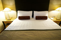 Double bed in the hotel Stock Photos