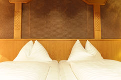 Double bed in hotel room Royalty Free Stock Photos