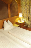 Double bed in hotel room Royalty Free Stock Images