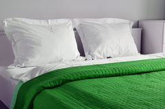 Double bed in hotel room. Accommodation Stock Image