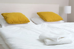 Double bed in hotel room. Accommodation Stock Photo