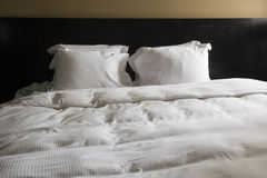 Double bed in hotel room, blanket and pillows Stock Image