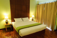 Double bed in the hotel room Stock Images