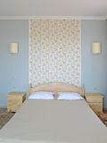 Double bed in a modern hotel room Stock Photo