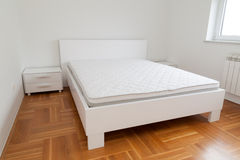 Double bed in modern room Stock Photos