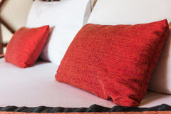 Double bed with pillows in red color.sensitive focus Stock Images