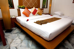 Double bed in traditional Thai setting Stock Photos