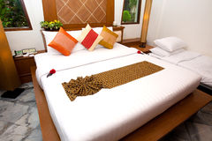 Double bed in traditional Thai setting Stock Images
