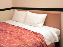 Double bed with two pillows. Served double bed with two pillows in hotel room Royalty Free Stock Image