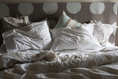 Double bed unmade, morning light Stock Photography