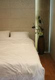 Double bed with white sheets and pillows Royalty Free Stock Images