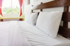 Double bed with window Stock Images