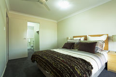 Double bedroom. Stylish double bedroom with ensuite in Australian townhouse Royalty Free Stock Photos