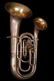 Double Bell Euphonium. Rare, antique double bell euphonium, gold wash inner bells, black iso Stock Images