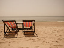 Double bench on beach Stock Photo