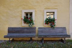 Double Bench with Window Flower Boxes stock image