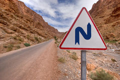 Double bend sign. Double bend warning sign in mountain desert road Stock Photo
