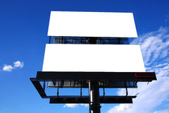 Double big outdoor advertisement billboard. Over blue sky Stock Photos