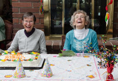 Double Birthday. Two elderly residents at an assisted living facility celebrate their birthdays Royalty Free Stock Images