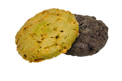 Double biscuit de chocolat et de farine d'avoine sur la coupure blanche de fond Image libre de droits