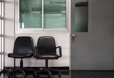 Double black chair in front of the manager room stock photography