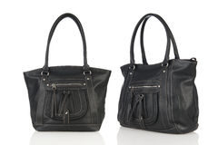 Double black leather handbag on white background Royalty Free Stock Photography