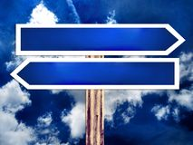 Double blank direction road sign and the sky Royalty Free Stock Photo