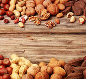 Double border of assorted fresh nuts Royalty Free Stock Photography
