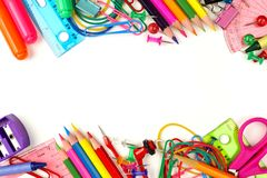 Free Double Border Of School Supplies Over White Stock Images - 56897844