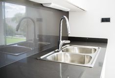 A double bowl stainless steel kitchen sink in a modern design Royalty Free Stock Photos