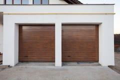 Double brown garage door in a new house. Double brown garage door in a new house stock photo