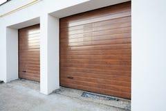 Double brown garage door in a new house. Stock Image
