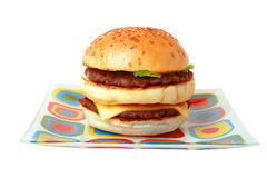 Double burger. On glass colour plate Isolated on white background Stock Photography