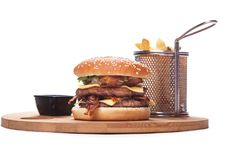 Double burger with cheddar and bacon,Burger with french fries on Stock Photo