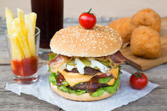 Double burger with french fries and fried balls Royalty Free Stock Image