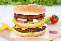 Double burger hamburger beef onion tomatoes lettuce cheese Stock Photos