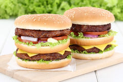 Double burger hamburger fresh beef tomatoes lettuce cheese Royalty Free Stock Images