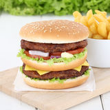 Double burger hamburger and fries beef tomatoes lettuce cheese Royalty Free Stock Photos