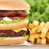 Double burger hamburger with fries closeup close up Stock Photos