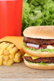 Double burger hamburger and fries menu meal combo fast food. Cola drink Royalty Free Stock Photography