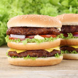 Double burger hamburger tomatoes cheese Stock Photography