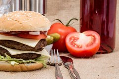 Double Burger with ingredients and cutlery Stock Photography