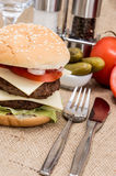 Double Burger with ingredients and cutlery Stock Photo