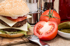 Double Burger with ingredients and cutlery Royalty Free Stock Images