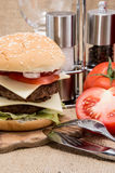 Double Burger on rustic background Stock Photo