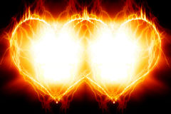 Double burning hearts Stock Photography