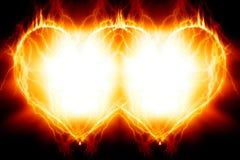 Double burning hearts. On black background Stock Photography