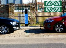 Double car recharging public station in street parking royalty free stock image