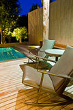 Double chairs. In swimming pool Royalty Free Stock Photography