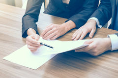 Double checking of the essential information about business project. A couple in formal clothes are looking at the documents. Stock Photo